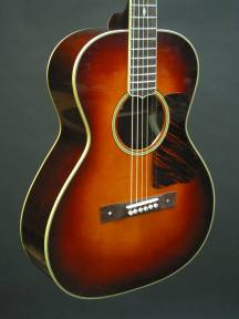 Vintage sunburst top with a tortoise shell pickguard.