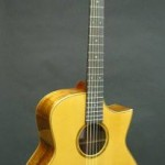 This Jumbo model was built as a fingerstyle performance guitar. It has a koa back and sides with a sitka spruce top and a sharp cutaway. Some comments from the owner after picking up his new guitar: