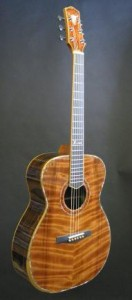 Orchestra Model Custom Acoustic with curly redwood top, ziricote rosewood back and sides