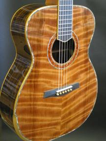 Curly redwood top with abalone purfling.
