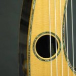 The second soundhole on the arm.