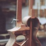 A shot of the Gibson Model U style Harp Guitar as it's being custom built.