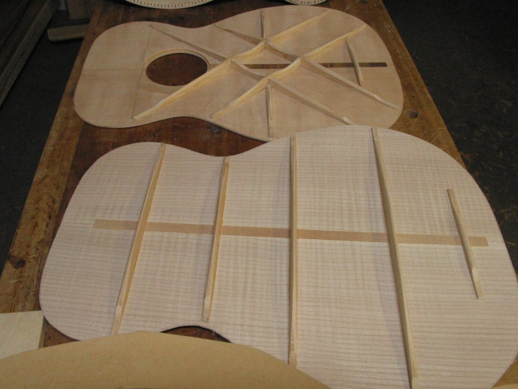 The top and back have been braced and are ready to glue to the rim to create the body of the mandocello.
