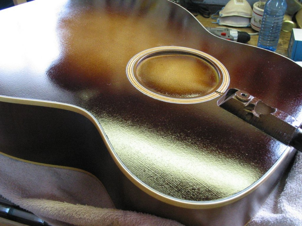 The tobacco sunburst has been sprayed on and I can take the masking off the binding.