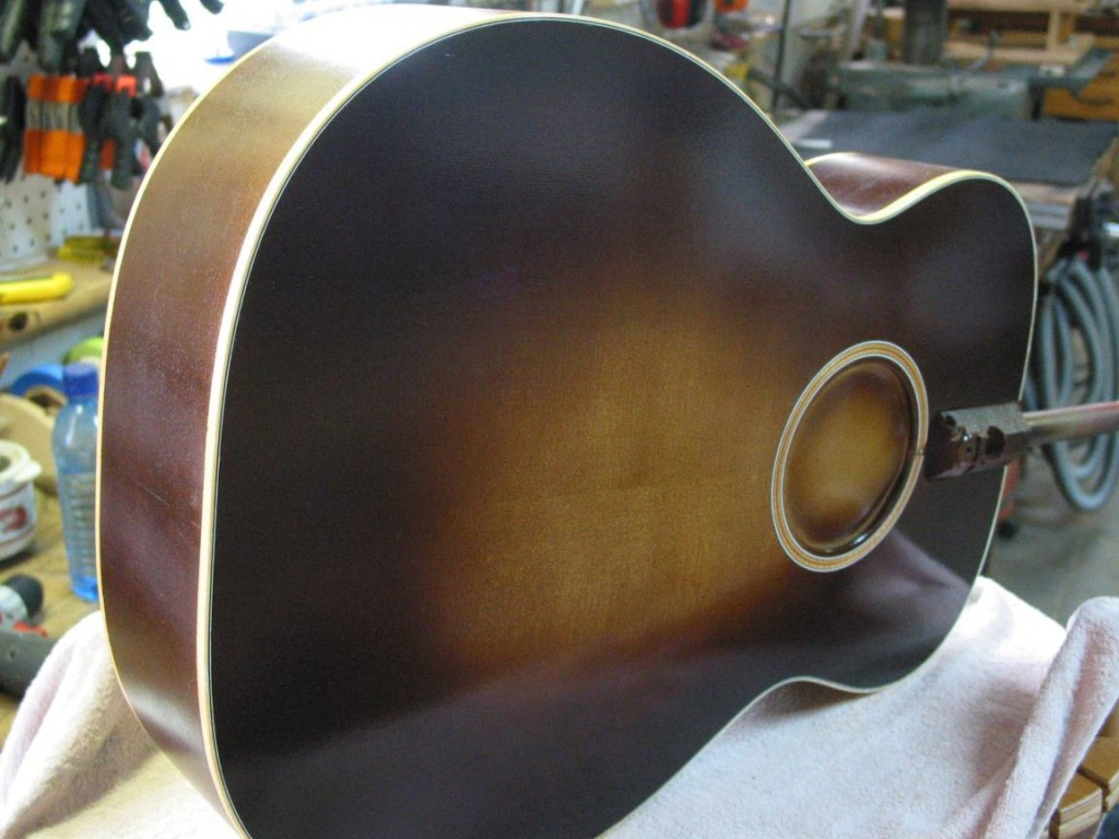 The tobacco sunburst has been sprayed on the the top, back and sides.