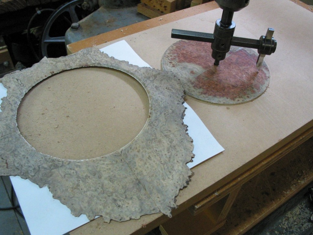 Here I am cutting a piece of amboyna burl wood to make the rosette. I use a circle cutter to cut out a ring of wood.