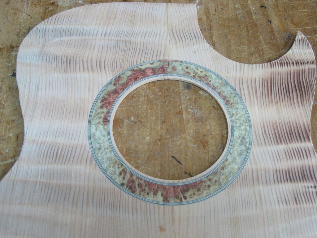 The ring of amboyna is inlaid into a channel in the top and sanded flush.